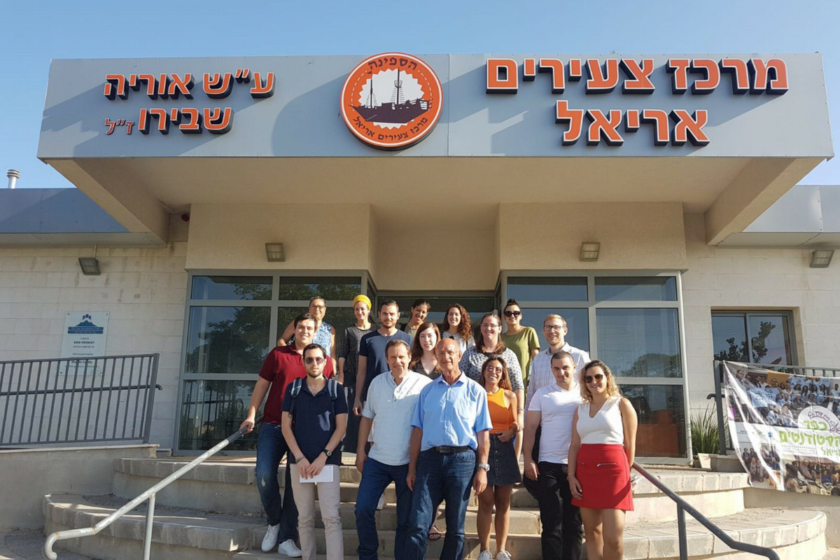 College students receive scholarships in Ariel, Israel. Taken at the Ariel Young Adult Center with mayor Eli Shaviro.